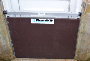 image of FloodKit floodboard providing flood protection for a doorway