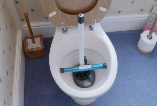 image of a floodkit toilet stopper installed as a flood prevention product for toilets